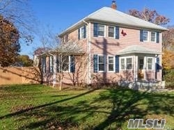 Charming 3 Bdrm Colonial located on beautiful 1/2 acre, Well Kept, Updated, Hrdwd Flrs, Walk in Closet in Master Bdrm, Spacious Open Floor Plan, Pull Down Attic Stairs, Basement, Detached Garage, Fence yard, Close to LIRR, in Sachem SD