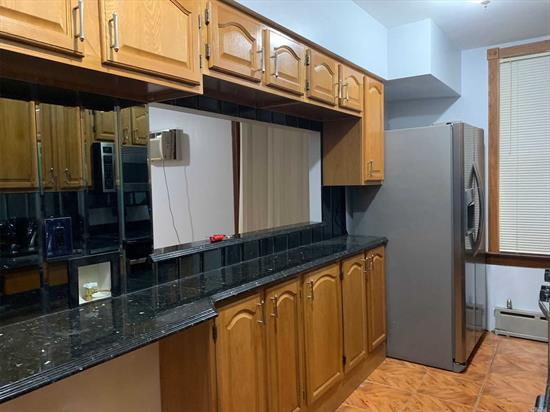 2 Bedroom of 1st floor of a two-family residence. Open living room area with enough space for a dining room table. Each bedroom has a lot of closet space.