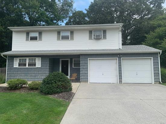Very Sharp 4 Bedroom Colonial/Splanch Features Hardwood Floors-3 Year Young Roof- 2 Car Garage- Part Basement- 200 Amp Service- Updated Natural Gas Cooking- Large Private Backyard- Newer Driveway- Close To Schools & Shopping.