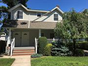 Updated Two Bedroom Second Floor Apartment Close to Main Street and LIRR. Laundry, Storage, Parking.