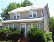 Legal Two-Family Incorporated Village of Valley Stream; Currently Tenant Occupied; One BR over Two BR's; Investment Property or Opportunity to Make Your Own;