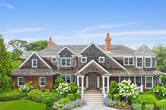 On one of the most desirable streets in the estate section of Quogue, this custom-built home offers luxurious living in a private setting. The 5600 sq ft home sits on 1 acre. A two-story foyer opens to a living rm, dining rm and cozy sitting area. The EIK includes an island and breakfast nook. A den w/ custom cabinetry, 2 car garage, powder rm, a 6th en-suite bedrm, and laundry complete the 1st floor. A Master Suite w/spa ba, 2 ensuite bedrms, 2 bedrms and bath on 2nd fl. Pool & Pool House.