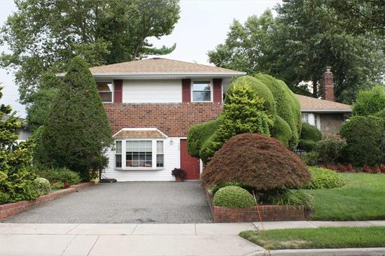 This Is The House You've Been Waiting For! Mid-Block Location, 3 Bedroom 2 Full Bath Large Split In Syosset Schools, Features Hardwood Floors, Brand New CAC, Open Floor Plan Extended Eat-In-Kitchen W Lots of Sunlight, Formal LivingRm, Family Room (Den), Office With Ose, Playroom, Lots Of Closets And Great Storage Space, Backyard With Brick Patio For Entertaining, Low Taxes! Convenient to LIE/Northern State.....Must See, Wont Last!!