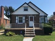 Beautiful brick cape with wood floors, large rooms, and close to transportation and schools.