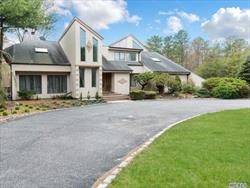 Behind the Gates/Oasis of Privacy! Outstanding contemporary has been stunningly designed. Offering 5 Bedrooms, 5.5 Baths On Shy 2 Acres. Open floor Plan W/soaring ceilings. XXL EIK w/granite counter and Viking appliances. Oversized bedrooms. Ig pool w/salted water. Room For All! Masterpiece That You Will Take Pride In!