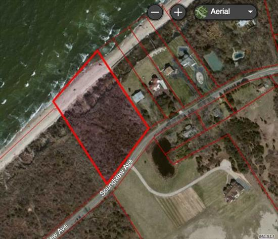 Beautiful 3.7 acre Soundfront lot on bucolic Soundview Ave. Permits in hand include: Sthld Town Trustee Permit to clear for 9650 sq ft. for Large home, pool, etc., Suff Cnty Health Dept Permit for 7 bedroom house. Non-Jurisdiction letter for NYSDEC. Pub water is down the street just east of Saltaire Way. 58 acre farm across the street just sold most of its development rights and is forever preserved. Entry to property is west of For Sale sign.