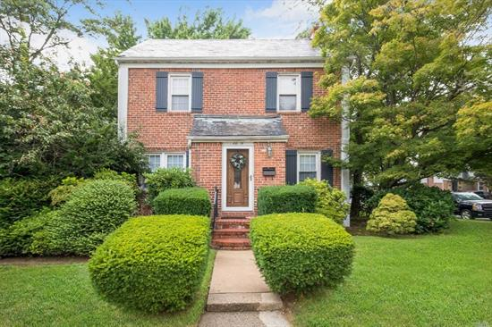 New To Market Beautiful Brick Colonial on Corner Lot In Bayside Hills! Oak Floors Throughout. Renovated Kitchen & Bathrooms, Full Finished Basement W. Separate Entrance, Slate Roof, New Boiler & HWH, School District 26 (PS 376, JHS 74 & Benjamin Cardozo HS) Shady Private Backyard & Detached Brick Garage. Terrific House At A Terrific Price!