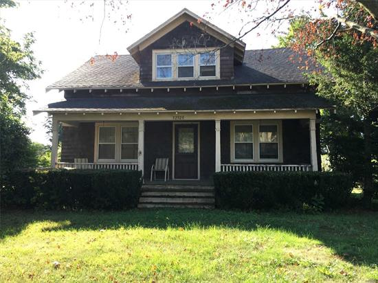 North Fork Farmhouse fixer upper with Residential Office Zoning. Nice level property with 100 feet of Main Road frontage and a detached garage located in the town of Cutchogue. Selling As Is with clear title and pre C of O - Best Offer!
