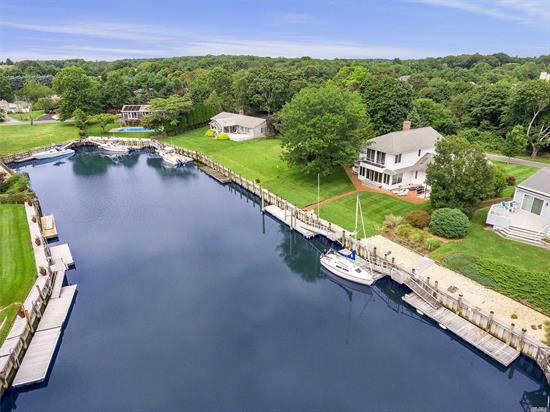Come to Cleaves Point and see your new home, perfectly positioned on Gull Pond, with direct access to Peconic Bay. Keep your 60' plus boat at your private floating dock, w/ elec & water, right outside your door! Surely enough room for you to summer with family, friends, and more! Home boasts a dockside Great room, newly renovated kitchen, and Master en/Suite. Private Beach community, outside of Greenport Village, on the cusp of East Marion. Private and serene location, nature lover's oasis!