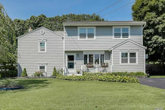 Incredible opportunity to own in West Islip. Stunning split on park like grounds comes complete with semi above-ground pool with extensive decking, in-ground sprinklers, double wide driveway, fenced-in yard and more. This home is perfect for entertaining and get-togethers, either in the formal dining room or out in the large, grassy backyard. Call this one home!