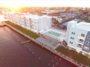 Spacious 2BR/2Bath Luxury Apt. w/ Massive Waterfront Balcony, Top of the Line Appliances & Fnishing. In unit W/D, Elevators, 24-Hr Gym, Heated Salt Water Pool, Community Rm w/ Business Center, Waterfront Boardwalk, Pavilion w/ Fire Pits & Seating! Garage parking & storage, pets welcome, dock to launch kayaks/SUP's, & boat slips available by request. Building offers finest amenities, services, & security w/ smart technology making this one of the finest communities to live in on the South Shore.