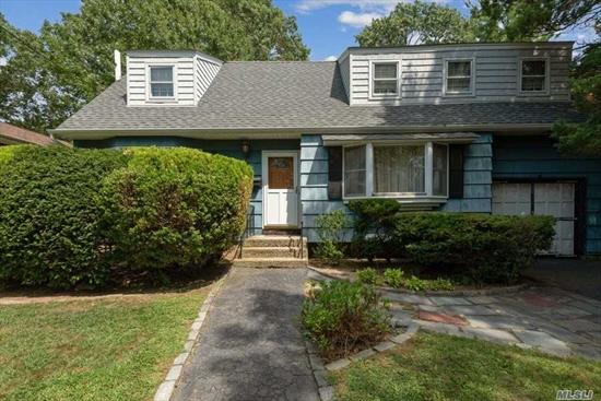 A spacious, expanded Westwood cape in the heart of the village just waiting for your vision! So much to offer with oak hardwood floors, mid block location, private yard, full basement, garage, and very sizable bedrooms.The size is truly impressive and the mid block location is unbeatable. Minutes to the village and train station.Investors, users, builders, come one and all and see what this property has to offer.