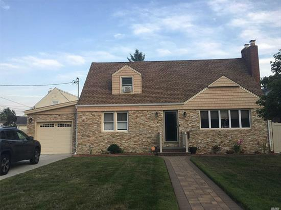 Beautiful Diamond Condition 1 Family Detached House With 4 Bedrooms And 2 Full Updated Bathrooms & Kitchen With Granite Counters and Floor . Full Finished Basement. New Roof, Stone Exterior, 200 AMP Panel, Boiler and Hot Water Heater, New Hardwood Flooring And Much More... Will Not Last!!