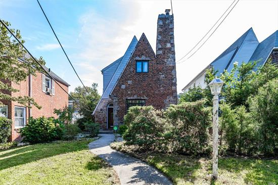 Old World Charm Meets City Living! Best Of Both Worlds And Potential For More. First Floor Features A Beautiful Living Room With Fireplace That Is Perfect To Unwind, Dining Room, Eat-In Kitchen, 3 Generous Sized Bedrooms, 2 Full Bathrooms, Wood Floors Throughout And So Much More. Blocks Away From Union Tpke, St. Johns University, The 'F' Train, Shopping & Restaurants. This Home Is A Must See !