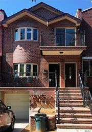 Brand New Brick 2-Family House In Downtown Flushing. Walk In Basement: 2 Entrance, Windows, Full Bath.  1st Floor: 2 Bedrooms, 2 Full Bath, Lr, Dr, Kitchen, 2 Patio. 2nd Floor: 4 Bedrooms, 2 Full Bath, Lr, Dr, Kitchen, 2 Skylight, 2 Balcony.