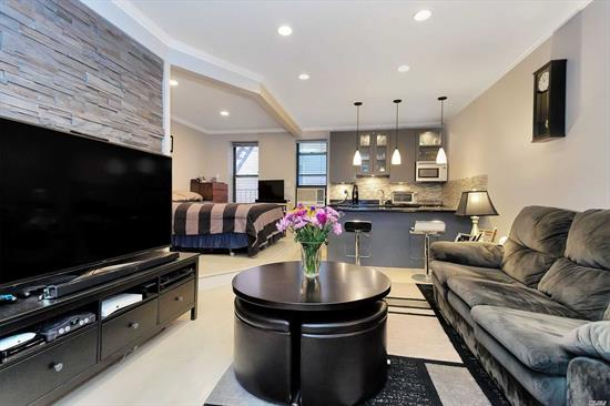 Fabulous Alcove Studio located at the Art Deco 29 Colony Coop in Astoria. This totally redesigned/gut renovated apt features modern finishes, sleek design, kitchen with black granite counter top, glass mosaic tile back splash, pendant lighting & SS Appls. Mosaic tile bath with body spray jets, living room with exposed stone accent wall, whitewashed hardwood floors & recessed lighting. Convenient location off 30th Ave, just 2 block to N/Q Subway Station plus restaurants/bars/shopping & more.