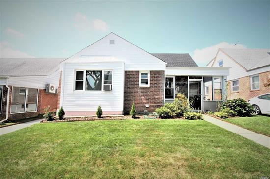Large, expanded 5-bedroom ranch on a 48' by 100' lot in a great location on the Flushing / Fresh Meadows border. This home features bedrooms on both levels as well as a finished basement. There is a convenient, enclosed front porch. The roof, driveway and siding were upgraded in 2015. There is a private backyard and long, private driveway. Easy commute via the Q31, Q27 and Q26 buses to the 7 or F train. Zoned for school district #26; PS 162 and JHS 216.