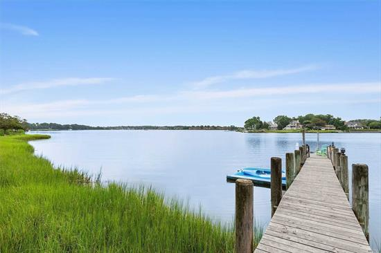 Bordering the 43 acre Maycroft Estate, this fabulous gated North Haven home is located in a quiet and private setting with beautiful open water views over Sag Harbor Cove. Undergoing a total renovation down to the studs in 2012, the 4500 square foot traditional set on a shy acre defines waterfront living in Sag Harbor. Exquisitely decorated with five bedrooms, including the first floor master suite opening to the pool area, four and one half baths with radiant heat floors, fabulous open chef's k
