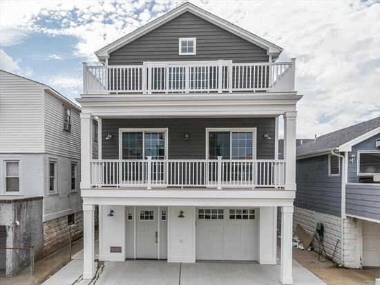 Entertainers Dream in the Trendy West End. New Construction/FEMA Compliant Home W/Elevator, Amazing Bay Views from Both Upper Decks. High Ceilings Upper Floor, Huge Island with Seating for 8, Wine Refrigerator, Viking Appliances, Open Clean Lines, White Oak Wood Floors, Hi-hats Throughout, Designer Baths.