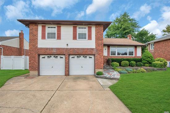 Westbury. Great opportunity to own a home in prime Salisbury Estates! Lovely Split level home featuring 3/4 Bedrooms, 2.5 Baths, Living room with Cathedral ceilings, Formal Dining room, New Hardwood Floors, possible 4th Bedroom or Den, full basement, 2 car garage,  Updated Windows, Mid-Block Location, Fenced-In Private Yard. 200 Amp Service. Low Taxes, Gas On The Street.