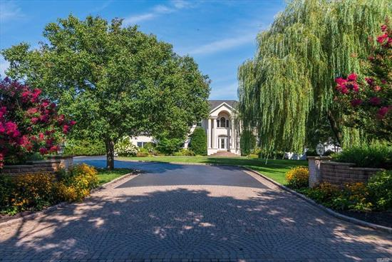 Stately Waterfront Colonial On Shy 1 acre property Down Coveted West Islip Rd..Tucked Away On a Private Tree lined Street within Walking Distance Of Downtown Babylon's Shops and Restaurants and Approx. 1 mile From The Babylon Train Station.This Magnificent Home Is an Entertainers Dream. IG Saltwater Pool, 125 feet of Bulkhead With Boat Lift, Built In Bar/BBQ Gazebo w Electric. Bright Kitchen Overlooking All, 2 Gas Fireplaces, Built ins, Extra Large Bedrooms, MBR Suite Overlooking Backyard.