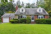 Beautiful Large 4 Bedroom, 2 Bathroom Cape.Hardwood Floors Throughout, CAC, Close to LIRR and Town.