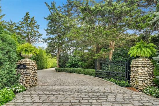 DIAMOND Custom Built 4 BR, 3 Bath Charleston Colonial w/Pillars & Outdoor Porches overlooking the L.I. Sound & your own Beach & IGP. This 3800 sq. ft. Masterpiece was Crafted w/Focus on Design, Materials & Quality Workmanship. Fully Appointed with an Elevator , that makes 2nd floor access easy at any age. There is a full Basement w/9' ceilings & int & ext. entries. The 2 Car Gar. is Det. & has a loft Storage (600 Sq Ft) The Elevation is 14', Therefore no Water Infiltration during Sandy, or Ever!