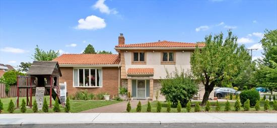 Magnificent Mediterranean inspired single family split-level home nestled on a corner lot in the prestigious town of Beechhurst. Carefully built by the owner for his family, this 4 bed 3 bath beauty boasts high ceilings, top tier craftsmanship, 3 fireplaces, & lots of small touches that create a wonderful living space full of charming details. Every inch of this space has been brought to its fullest potential with both design & function in mind. Close to parks, shopping, commute & much more.