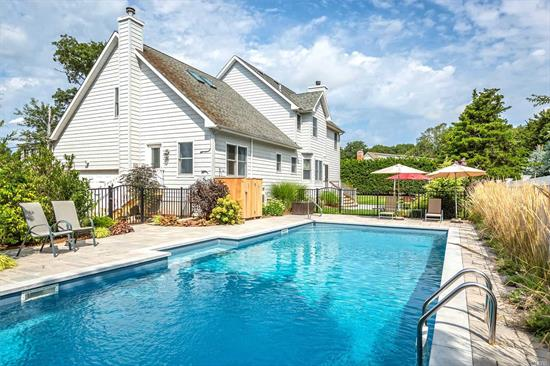 WISH LIST: Private sandy Peconic bay beach? Yes! Heated saltwater pool? Yes! Close to Love Lane restaurants, shopping, theatres, vineyards? Yes! Nearby marina? A bonus! This stylishly sophisticated 4 bedroom 3 bath home checks off all your Must Haves. New kitchen & baths, hardwood floors, CAC, fireplace, 2 car garage, expansive stone patio & sought out privacy.