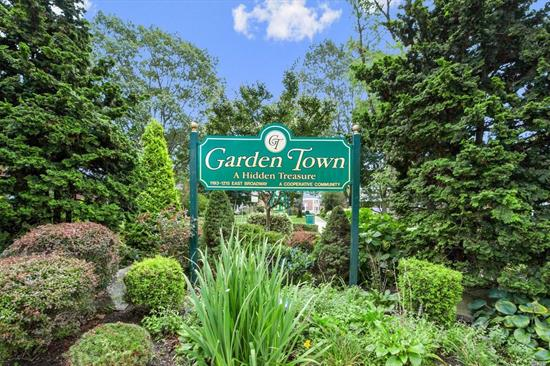 Spectacular & Spacious 2BR, 2BA Co-op Situated On The Well Maintained Grounds Of Garden Town. Very Large Entrance Foyer, Updated Kitchen & Baths, New Wood Floors, Crown Molding Throughout, Washer/Dryer In Unit, Closets, Galore Plus Attic For Additional Storage. Beautiful Terrace W/Great View. Near LIRR.