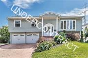Updated 5 bdrm 2 full bath on over 1/4 acre! Vacation in your resort-like backyard. Gorgeous landscaping with in-ground pool. Upgrades include: 2013: Kitchen, 2 Bathrooms. Roof, Electric, Siding, Windows. 2014 Pavers and Pool. Landscaping, Central Air 2016. Great block, X Zone. Won't Last!!