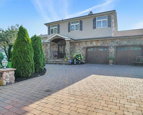 Must See! Nassau Shores, Master suite with Balcony, Bath With Sauna, Custom Walk In Closets. Open Floor Plan, Living Room W/Fireplace. Gourmet Kitchen W Granite,  Spacious Family Room,  Perfect Yard For Entertaining Complete With In-Ground-Pool. 2 Zone Central Air, Security System, 2 Car Garage.