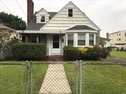 GREAT OPPORTUNITY!!!!! Charming Cape w/ 4 BRMS, 1Bth, LR w/ fp, DR, EIK, Full BSMT. LARGE LOT! Make this your own with a personal Renovation. LOTS of Potential!! Home is being sold AS-IS. Minutes to Molloy College, Shopping & Parkway. Builders welcome,  2 LOTS Sold together. (Sec:36 Block:12 Lot: 146 & Sec: 36 Block: 12 Lot: 246)