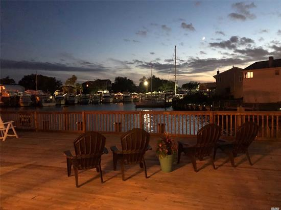 Boaters paradise and Entertainers Dream, Over 3000 Sq' of living in this S. Freeport Waterfront Home on Deep Wide Canal W/Large Dock, New Bulkhead, Multi leveled Decked Backyard. Open Fl plan - 1st Fl New Kitchen, Great RM W/Wood Burning Stove, Dining RM, Living RM, BDRM, FBTH, Laundry RM & Utility/Tool RM - 2nd Fl. BDRM W/Balcony, BDRM W/Loft, New FBTH, Partial BSMT