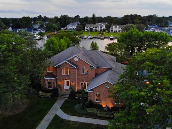 Custom waterfront home on widest and deepest portion of desired Fosters Creek. Open floor plan with a gourmet kitchen, great room, living room with gas FP, formal dining room, guest room/den w/full bath. Second floor master bed with dressing room, ensuite, 3 additional bedrooms, full bath. Resort style yard with 1200 sqft travertine terrace, custom gunite pool, and protected boat slip.
