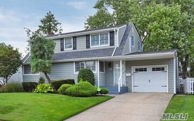 Commuter's Dream! Lovely home w. terrific curb home sit. mid block w. fenced-in yard. This home boasts lr w. lrg pic windows w. beautiful backyard view, eik w. island & SS appls, Lrg. MBR w. Skylt. & sitting area, updated bath, hw floors on 1st fl, new carpet on 2nd fl. and basement, rec'd ltg., newer roof and siding (4 years old), newer split units, new garage door and much more. Close to Meadow Dr. Elementary, Shopping Ctr., LIRR, Clark Botanical Gardens, Restaurants, etc.