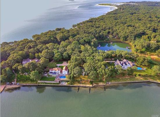 Diamond in the rough! A Rare Paradise Point Bayfront Opportunity in a Stunning Location that offers Spectacular views of Southold Bay, Shelter Island and Breathtaking Sunsets. 175' on the water, Wooded, Private and an Association Marina Basin just steps away!  Fulfill your Dream in this Spectacular Estate Setting by Updating a Four Bedroom Ranch with large, sprawling footprint. Great Potential, Must See!
