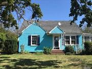 Cute Cape Cod style home that features 3 bedrooms and 2 bathrooms, living room, kitchen, and dining room.