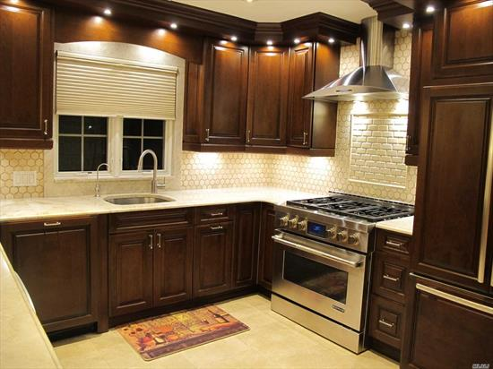 TRULY A STUNNING RESIDENCE RENOVATED TO PERFECTION CROWN MOLDING/HARDWOOD FLOORING/GAS COOKING/GOURMET EAT IN KITCHEN WITH BREAKFAST NOOK AND OPEN SPACE LIVING ROOM. ENTIRE APARTMENT PAINTED WITH VENETIAN PLASTER. TERRACE FOR THE MORNING COFFEE AND GLASS OF WINE ON SUNSET JUST THE RIGHT PLACE TO LIVE! ALL APPLIANCES TOP OF THE LINE AND ENERGY SAVER. ENTIRE APARTMENT BEEN RENOVATED ON 2014/15- LITTLE DOGS WELCOME! SHORT DISTANCE TO WATERFRONT PARK, POOL AND MARINA. QM2, QM32, QM20 TO MANHATTAN.