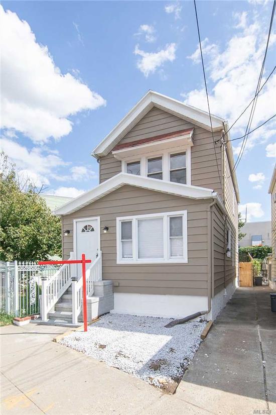Welcome to this meticulously updated colonial in the heart of Briarwood. This house has an open concept first floor with a full bathroom. Gorgeous hardwood floors throughout. There is a full finished basement with washer & dryer hook up, & a full bathroom. Upstairs has 3 spacious bedrooms and spacious bathroom. Close to everything, Hillside ave, Queens Blvd, and F train. Bring your furniture, and move right in