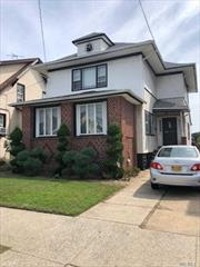 This lovely waterfront home has lots of potential. Features very large rooms, porch in front and sunroom in back. Great for boat lovers offering dock space and 2 boat slips. Located in Old Howard Beach on quiet block. Must see!! Also near schools and transportation to Manhattan- express bus and A train.