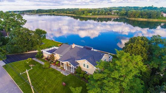 Spectacular water front expanded ranch with water views from every room offers over sized principle rooms. Enjoy the serenity that most people dream of but few can have. This home sits on a flat parcel with a separate area for a pool. An Entertainers delight with multi level decks one off the kitchen and lower level with with french doors that lead you to the patio and your own private beach. Oil Burner 5 Years Old, Fido's Fence, Surround Sound, Hurricane Shingles, Trex Deck, Approx 4, 200 sq ft