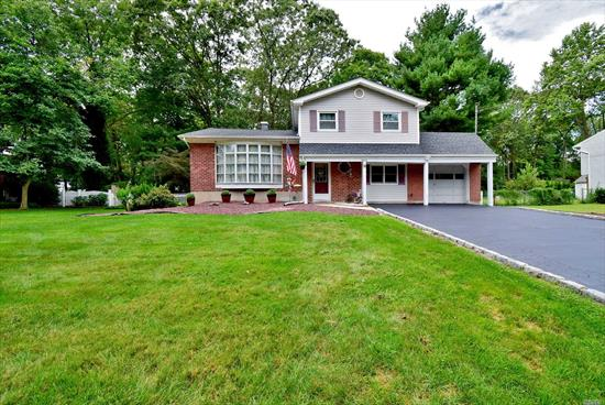 Lovely Split With Updated Kitchen & Bathrooms On Half Acre Located In Famed Hauppauge School District. 15x14 Master Suite w/Dual Entry Into Bath, 2nd Br, 18x9, Family Rm w/ Fireplace & Bedroom. Beautiful Finished Hardwood On First Floor, New Heating System w/Hot Water Heater, 4 Zone IGS In Front Yard Only. Ceiling Fans In Br's, Kitchen & Den, Fujitsu AC/Heat Unit (24, 000 BTU's) 200 Amp Electric, Maintenance Free Correct-A-Deck w/Vinyl Railings. Suburban Termite Contract. All C/O's In Place..