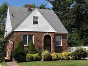 Charming Cape Style House Sets on 60 X 100 Lot in Bellerose Manor. #26 School District. Property is right off Union Turnpike and Allypound Park. Easy access to public transportation and major highways. The house has a huge backyard. Renovated kitchen, bath, and a brick patio. New siding and big driveway. Great for growing family and entertaining.