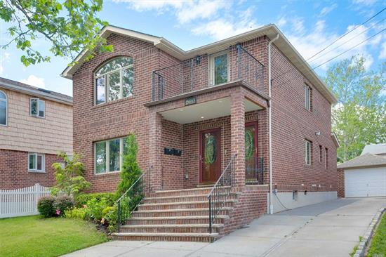 Solid All Brick 2012 Rebuild Legal Two Family ! Luxurious Living Space With Open Floor Plan To Offer Great Flow For Entertainment. 6 Bedrooms 4.5 Baths. Full Finished Basement With Bath & Sep Entrances. Very Convenient Location, Shopping Closed To Transportation Bus Q15, Qm20, Q16 To Main St Flushing. Whole House can be delivered vacant ! !Great Investment Opportunity.