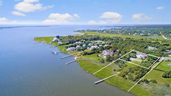 Spectacular 3 plus acre Bayfront property with over 200ft of water frontage. The house is approx, 4500sq ft with 5  bedrooms including 2nd floor master suite. Large living room, dining rm, breakfast area, den, billiard room. Outside has deck surrounding heated pool, hot tub and tennis court. Great opportunity to build the home of your dreams or renovate and expand the current house.