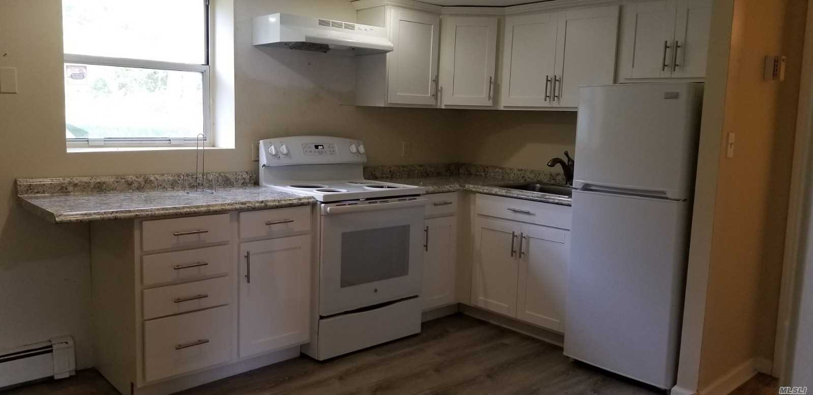 This Recently Remodeled, Freshly Painted 1 Bedroom Beauty Features New EIK and Newly Tiled Bath! Use of Yard.