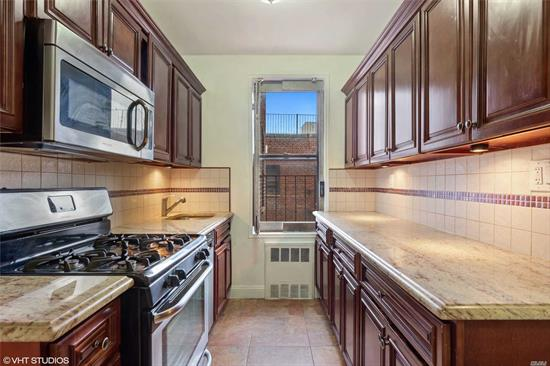 Perfect TRUE two bedroom. Bright Corner unit, tons of natural light. Renovated windowed eat-in-kitchen featuring granite countertops, stainless steel appliances. Renovated windowed bath. Gleaming hardwood floors. Great closet space. Parking and storage with waitlist. Dogs OK!!