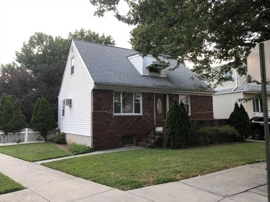 3BR/1BTH Cape located on corner 4400 sq ft lot located 1 block from KISSENA PARK. Prime location: potential knockdown and rebuild, dormer or renovate and live. House features: Solid hardwood floors, separate formal dinning room, large backyard, full finished dry basement with dry bar.