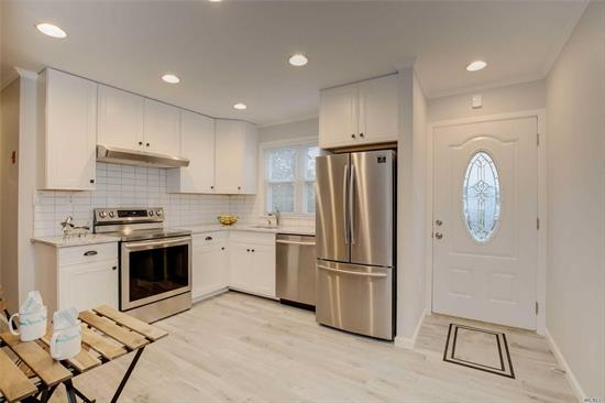 Wantagh. Must see this Beautiful Expanded Ranch, featuring 4 Bedrooms, New Baths, Brand New Kitchen with Stainless Steel Appliances, New Roof, New tiled Floors, New Carpets, Huge backyard, 200 AMPS Service. Can be Mother/Daughter with Permits. Looks like a Brand new house!
